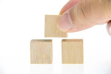hand holding wooden toy blocks