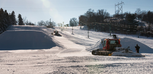 Workers build terrain park at  ski field, Afton Alps, Minnesota,