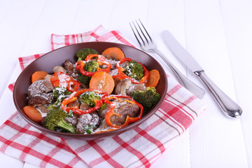 Braised wild mushrooms with vegetables and sauce in plate