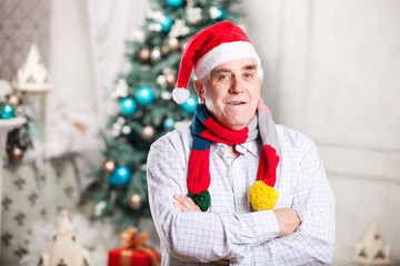 Mature man in Santa's hat and bright scarf
