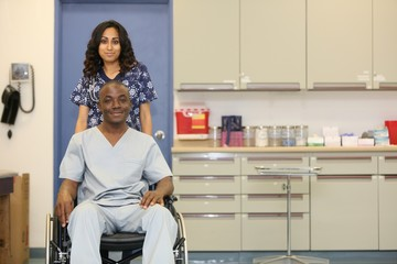 Hospital Medical Attendant with Wheelchair Patient