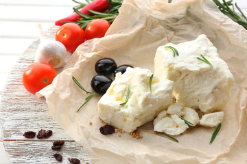 Feta cheese on table