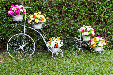 Bicycle inventor of both adorned with beautiful flowers grass.