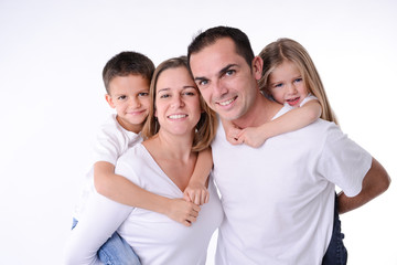 isolated studio shot happy family of four with little kids