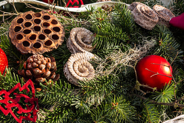 christmas background with toys, cake and fir-cones on fir tree b