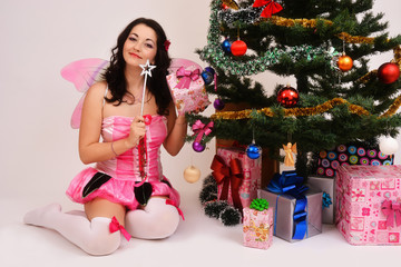 Fairy Christmas, sexy girl with tree and gifts