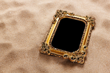 Gold frame on sand with path