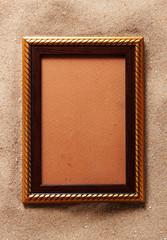 Gold frame on sand