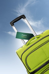 Fresno, California. Green suitcase with label