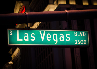 Las Vegas Boulevard street sign at night.
