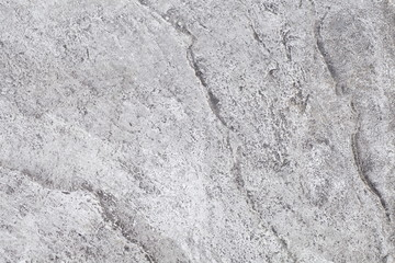 Gray natural stone texture and seamless background