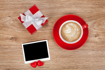 Blank photo frame, gift box and red coffee cup