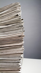 Stack of newspapers from the side