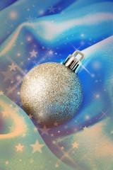 Beautiful Christmas ball on satin cloth, close-up