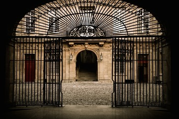 Old building entrance behind metal gate