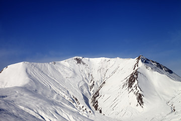 Snowy mountains in wind day