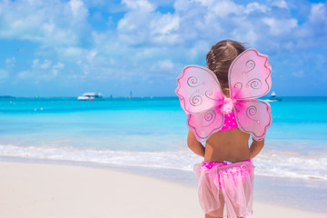 Cute little girl have fun on beach summer vacation