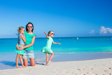 Little cute girls and young mother during tropical beach