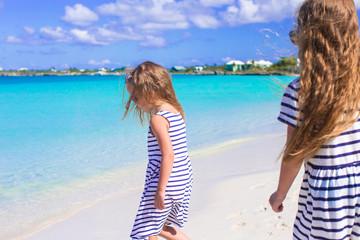 Little girls having fun during tropical beach vacation