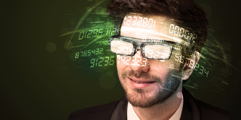 Business man looking at high tech number calculations