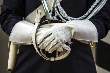 Close up view of a guarding police uniform hands with gloves.
