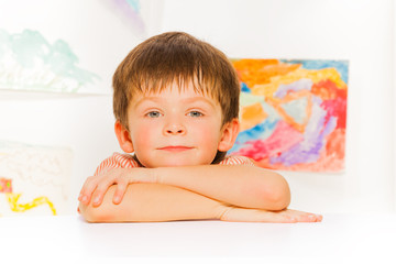 Calm portrait of little boy lay on the table