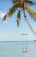 swing against the background of the tropical sea landscape