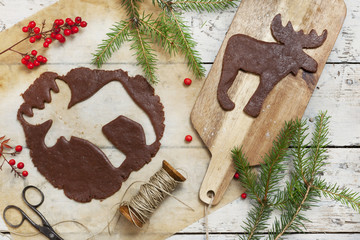 homemade gingerbread elk shaped cookie for Christmas on table