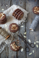 homemade gingerbread and almonds cookies on rustic table