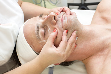 man in a beauty salon facial and massage