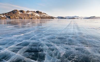 Lake Baikal winter morning. Ice road on Olkhon island