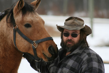 Bearded Man Standing With his Horse