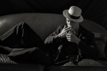 Stylish Smoker. Fashionable Young Man Lighting a Cigarette