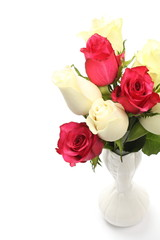 Bouquet of white and pink roses in vase over white