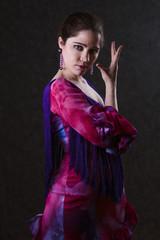 Graceful woman in a magenta evening dress