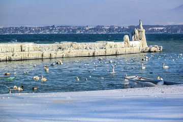 Frozen jetty and lighthouse at Versoix, Geneva, Switzerland