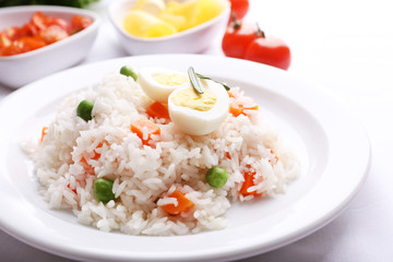 Vegetable rice served on table, close-up