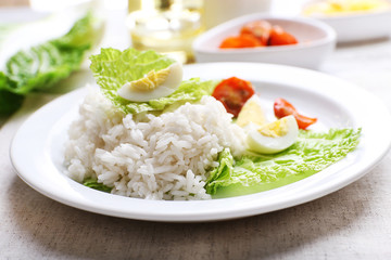 Boiled rice served on table, close-up