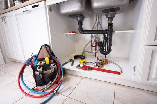 Plumbing tools on the kitchen.