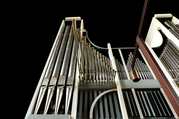 Low angle view of church organ on black