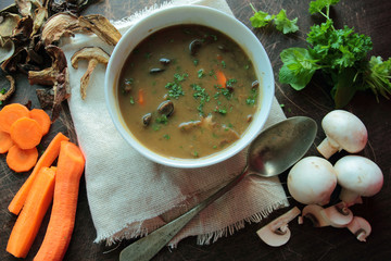 Bowl with mushroom soup with fresh parsley