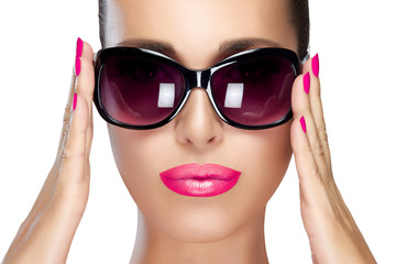 Beautiful Model in Black Fashion Sunglasses. Bright Makeup and M