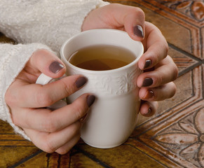 Young Woman holding hot cup of tea