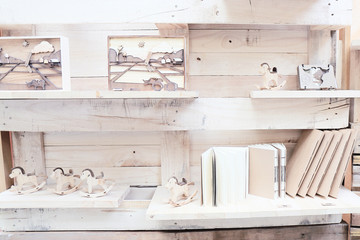 wood shelf with book and toys