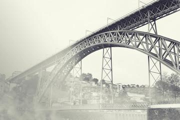 Dom Luiz bridge in the fog. Vintage picture. Porto, Portugal