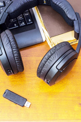 Headphones USB flash drive and computer keyboard