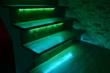 Photo sur Plexiglas Escalier Illuminated wooden stairs