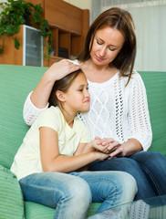 Mother comforting teen