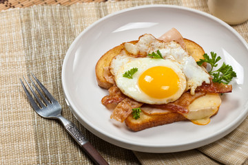 Sandwich with fried eggs - Croque Madame. Selective focus.