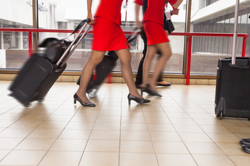 Women carries their luggage at the airport